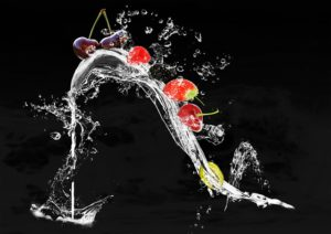 The picture of a flow of fresh water loaded with appetizing looking fruits.