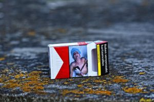 The picture of a terminal man illustrated on a pack of cigarettes.