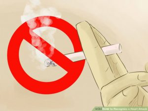 The illustration of a cigarette in a hand, with a red line in a cirle through it.