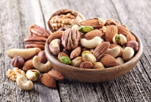 The picture of an assortment of nuts, in a bowl.