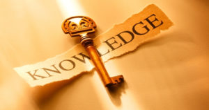 The picture of a key overlaying the word of knowledge.