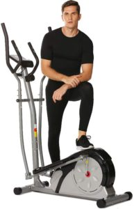 The picture of a man standing near his Ncient elliptical trainer.