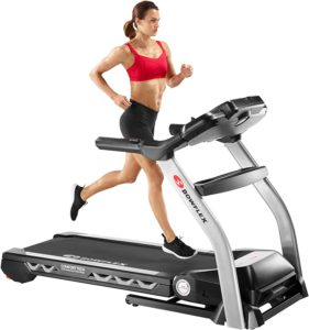 The picture of a woman during her exercise routine on a bowflex treadmill.