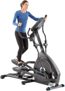 The great picture of a woman utiling here Nautilus E616 Elliptical Trainer.