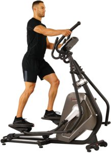 Best joint health supplements. The picture of a man exercising on his Elliptical machine
