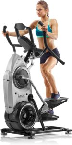 The pictire of a very built woman engaging her Bowflex MAX Trainer M7